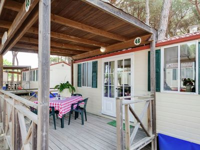 Photo for Mobile home in green pine forest with lagoon pool at a short walk from the sea.