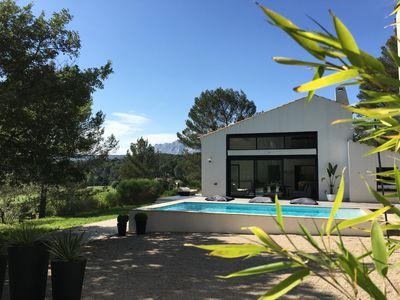 Photo for Contemporary villa at the foot of SainteVictoire, in the heart of a pine forest