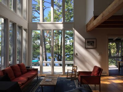Double height living room with woodstove