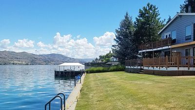 Large grassy yard to relax on or jump in the lake for a cool, refreshing swim!
