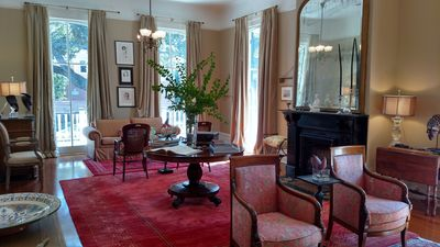 The former ballroom, now living room, offers tasteful antique furnishings.