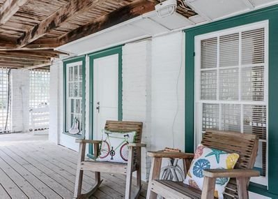 Welcoming rocking chairs greet you to this charming retreat