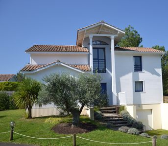 Photo for Villa with heated pool and garden by a golf course, 700 m away from the ocean