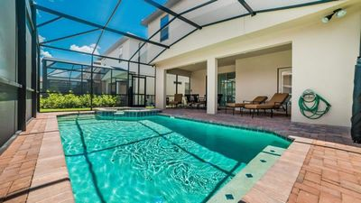 Photo for Picture Relaxing by Your Private Pool in Your Beautiful Villa in Windsor At Westside Resort, Orlando Villa 1731