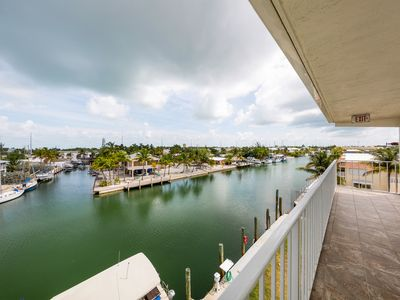 Photo for Canal-front condo w/ balcony - near Sombrero Beach, steps to dining/shopping!