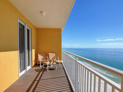 Photo for Gulf views from the living room of this waterfront condo plus shared pool & gym