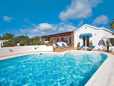 Photo for Highly furnished villa w/ well kept garden, pool table & heated pool
