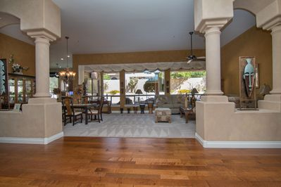 Open concept Formal living  & dinning room with a great view of the backyard .