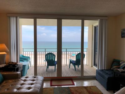 Watch for dolphins from the living room.