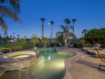 Photo for Gorgeous private POOL Home sitting directly on 2nd Hole of Palmer Course