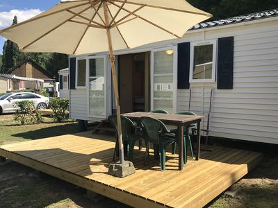 Photo for Neat mobile home with porch, in the nature outside of Paris