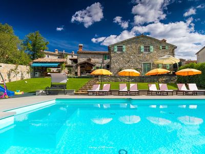 Photo for Idyllic property with 4 villas in Buzet