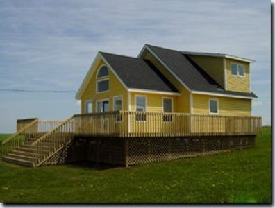 Photo for Cousin's Shore Beach, Oceanview, Private Cottage - PEI Ocean Villa