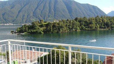 Photo for AMAZING view of the lake, with terrace, near the beach
