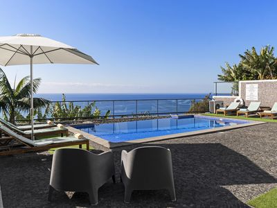 Photo for Modern, tranquil, A/C, heated pool. A balcony over the ocean! | Grayci's House