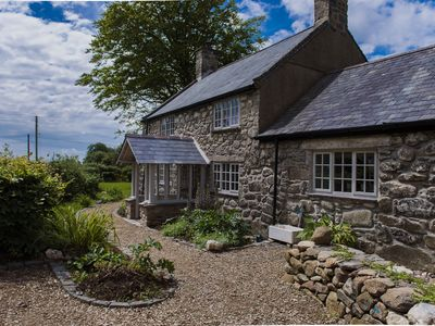 Photo for Superb 5 star graded 4 bedroom Farmhouse with large gardens with sea views