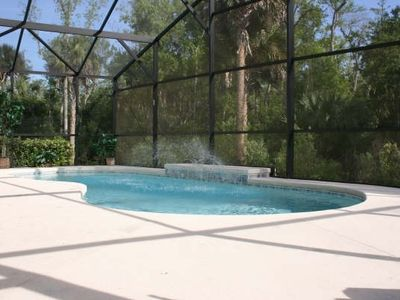 Photo for Luxury 4 bed pool villa, 15 minutes from DisneyWorld
