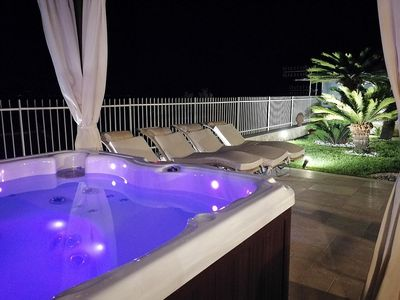 Photo for Beautiful Apartment with Private External Jacuzzi, Breathtaking Sea Views in the Heart of Taormina!