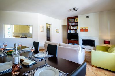 Large sitting and dining room with air condition and satellite TV.