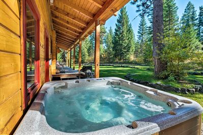 Ten guests can enjoy access to the home's hot tub, fire pit & private acreage.
