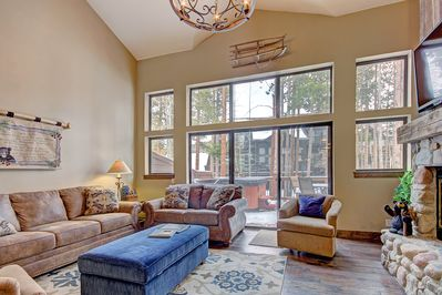 Spacious living room featuring large windows to allow in plenty of natural light