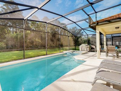 Photo for NEW LISTING! Luxurious house with private pool and spa - minutes from Disney!