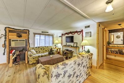 You'll find wonderful hardwood floors throughout the rustic cabin.