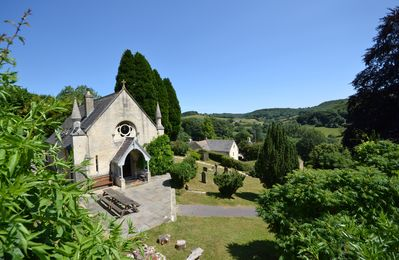 Photo for Contemporary luxury in old Cotswolds chapel - Stunning valley views. 4 bedrooms.