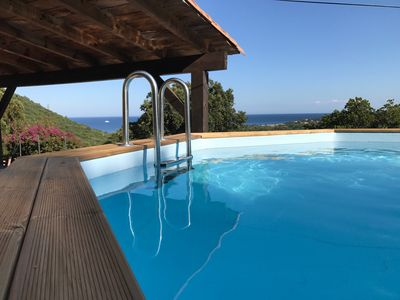 Photo for Stone villa with pool facing the sea
