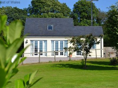 Photo for The large windows of this secluded, comfortable and well-equipped cottage allow for stunning views o