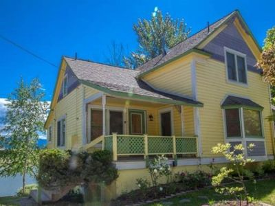 Photo for Waterfront Victorian home w/ a gas fireplace, dock, & beautiful view!