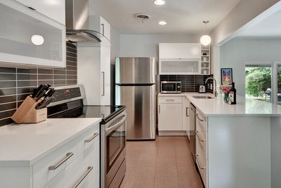 Fully stocked kitchen with Caesarstone countertops and LG stainless appliances