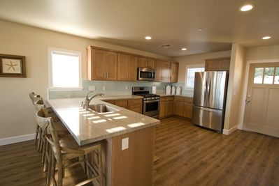 Brand new Kitchen including all new appliances, quartzite counter-top, and new c