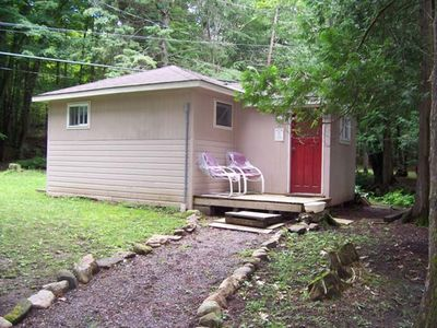 Bunkie is situated behind the main cottage.