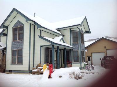 Front of house with snow on the ground.  Driveway to right.  Fits up to 6 cars.