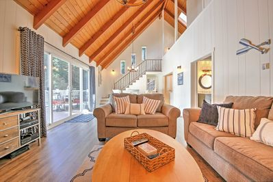 Experience luxury when you stay at this nautical-style house with a large deck just across the street from Lake Arrowhead.