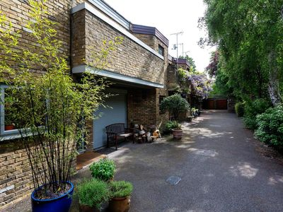 Photo for Modern & flamboyant home in an enchanting mews with lovely garden patio (Veeve)