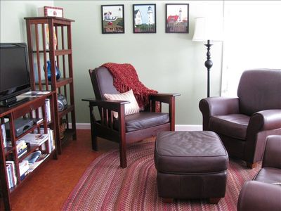 Comfy leather chairs, braided rug