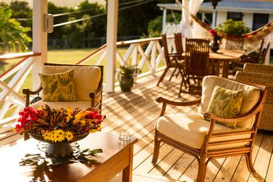 Outdoor seating area and dining area for up to 4 guests on large verandah.