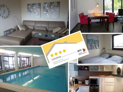Photo for Excl. 4-star apartment with swimming pool, sauna, sea view, underground parking for 4 pers.