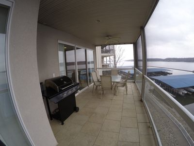 Beautiful View on Screened in Balcony with BBQ Grill and Patio Furniture!