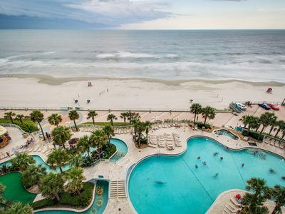 Photo for Oceanfront condo with shared pools/hot tub & Jacuzzi tub - snowbirds welcome!