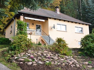 Photo for Idyllic holiday home situated on a sunny, south-facing slope at the edge of the forest