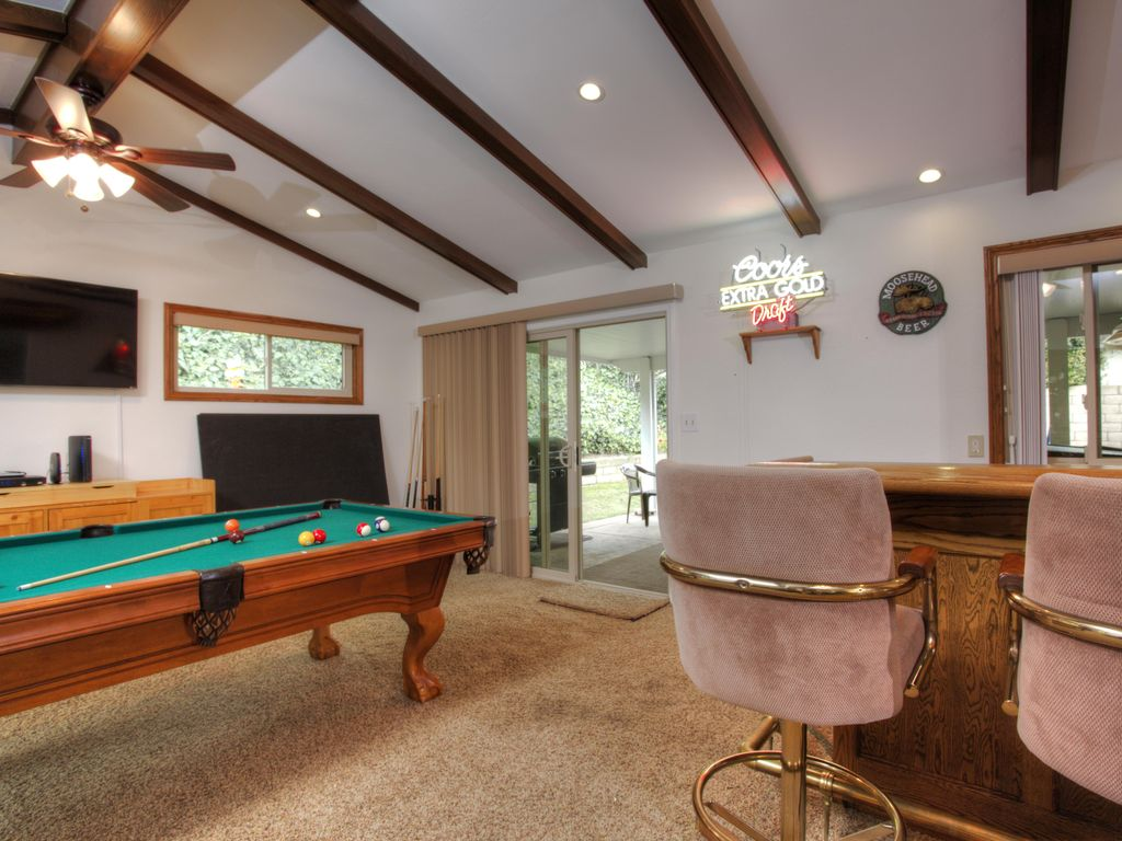 pool table room with bar. family game room with wet bar pool table ping pong darts and more a