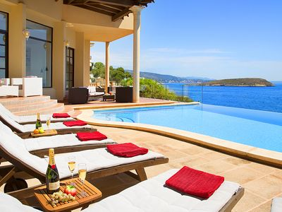 Photo for AWESOME LUXURY SEA FRONT VILLA WITH HEATED JACUZZI, INFINITY POOL, BEACH 5 MINS