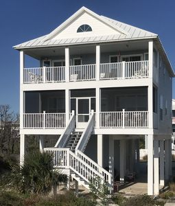 A Tropical Breeze from beach side. New light blue exterior and screen porch.