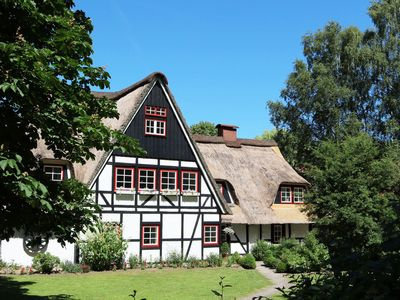 Photo for Thatched cottage with 6 apartments, group room, sauna, garden, playground