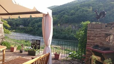 Photo for CHARMING HOUSE FACING THE TARN AND FULL SOUTH IN VILLAGE MEDIEVAL CLASS (wifi)