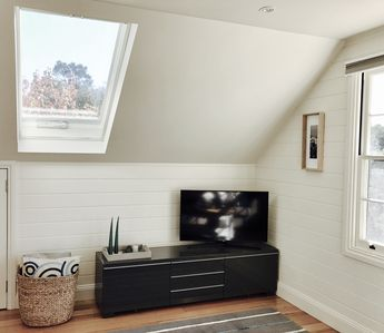 Roof windows fill the space with natural light and ventilation