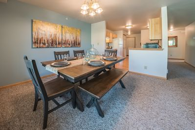 Spacious formal dining with open living.